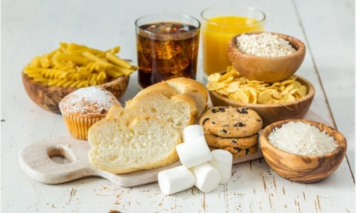 How does a high-carbohydrate diet affect patients with heart disease?